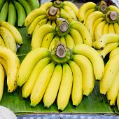 stock photo of bunch bananas  - Bunch of bananas on banana leaf background - JPG