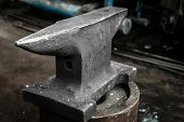 stock photo of anvil  - Steel anvil in a factory closeup photo - JPG