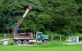foto of truck farm  - Old Drilling rig getting ready to drill a well in a farm - JPG