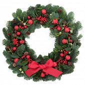 foto of christmas wreath  - Christmas wreath with red bauble decorations and bow - JPG
