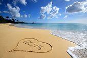 stock photo of happy new year 2014  - Heart on the beach  - JPG