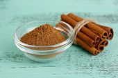 picture of cinnamon  - Cinnamon bark and cinnamon powder on wooden table - JPG