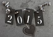 image of slating  - 2015 on slate background with heart and streamers - JPG