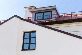 stock photo of gabled dormer window  - Gable of residential house with dormer window and chimney - JPG