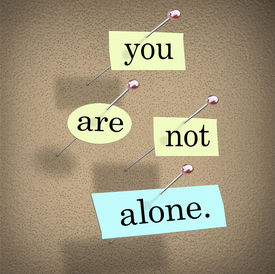 pic of feeling better  - You Are Not Alone words on paper pinned to a bulletin board assuring you you - JPG