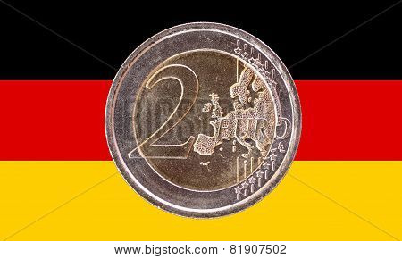 Common Face Of Two Euro Coin On Flag Of Germany