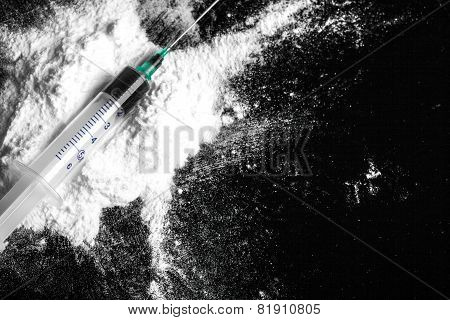 Cocaine drugs heap with syringe
