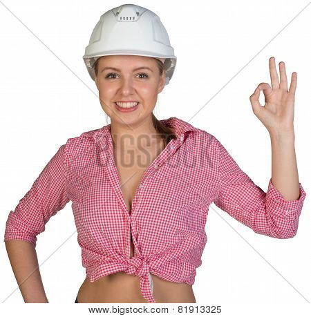 Woman in hard hat making okay gesture
