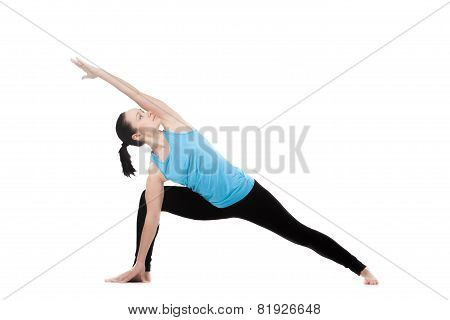 Yogi Female In Yoga Pose Uthitta Parshvakonasana