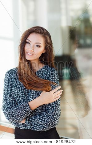 Portrait of a beautiful young woman in summer.