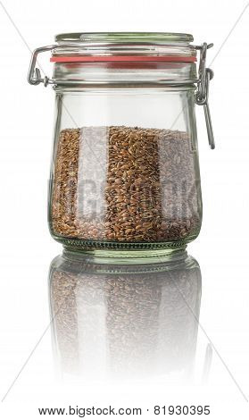Flax seeds in a jar on a white background