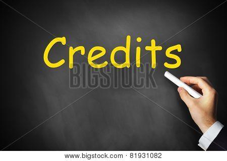 Hand Writing Credits On Chalkboard