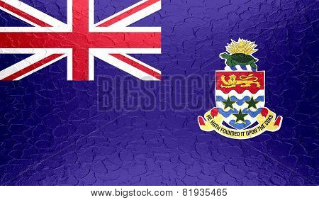 Cayman Islands flag on metallic metal texture