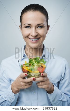 Cheerful Woman Eating Salad