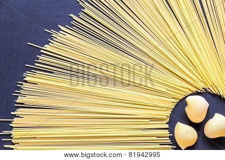 Lumaconi And Spaghetti Pasta On The Dark Background