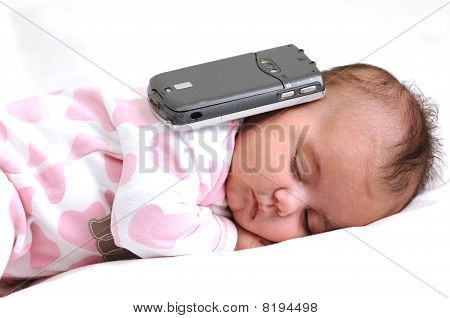 infant baby sleeping with a mobile phone