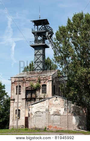 Old coal mine shaft with a mining tower