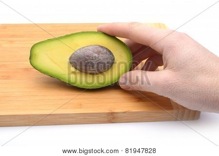 A Sliced Avocado On A Cutting Board