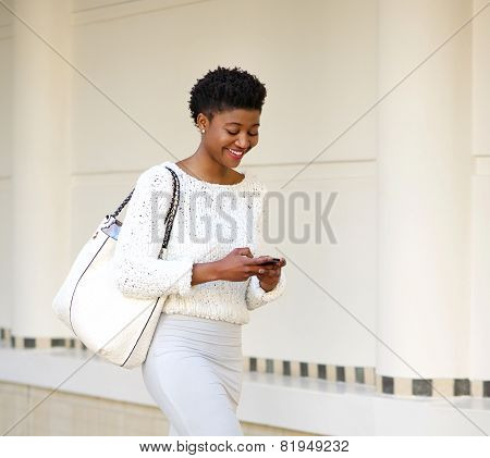 Smiling Woman Sending Text Message On Mobile Phone