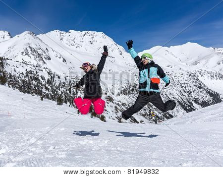 Happy Couple Jumping In Mountains