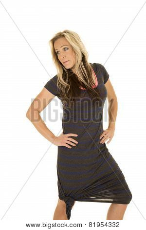 Woman Dark Dress Hands On Hips Look To Side