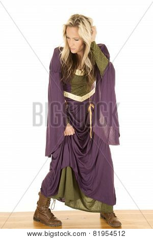 Woman In A Purple Dress Stand On Wood