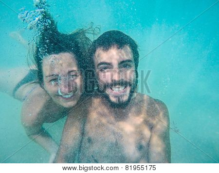Beautiful Couple Swimming Underwater. Selfie At The Caribbean Mexico. Bubbles In Motion.