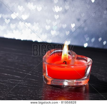 Red Burning Heart Shaped Candle On Silver Hearts Bokeh