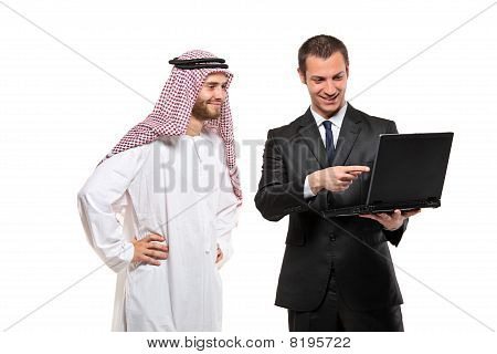 Happy businessmen with a laptop computer