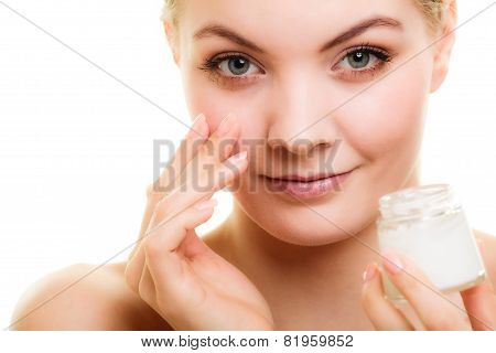 Girl Applying Moisturizing Cream