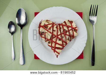 Handmade red heart on plate