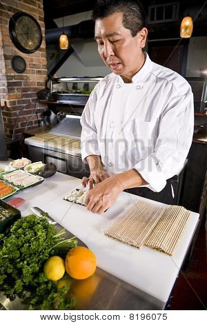 Japanese Chef In Restaurant Making Sushi Roll