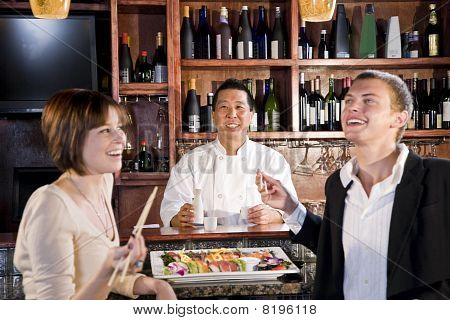 Couple Eating Sushi In Japanese Restaurant
