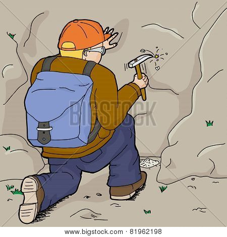 Kneeling Geologist Working Alone