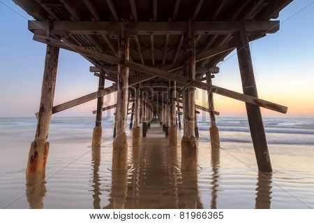 Under newport Beach pier after sunset