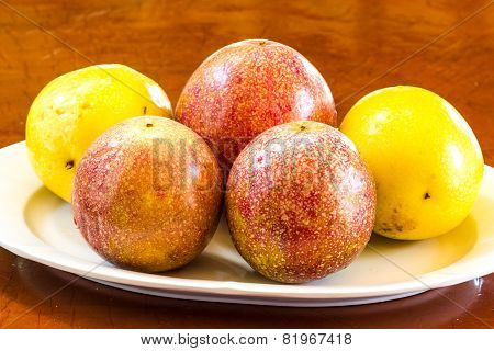 Passionfruits On White Dish.