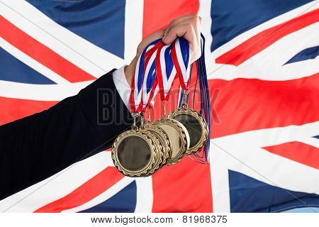 Businessperson Holding Medals