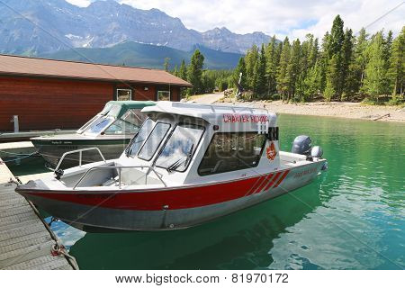 Charted fishing boats at Lake Minnewanka in Banff National Park