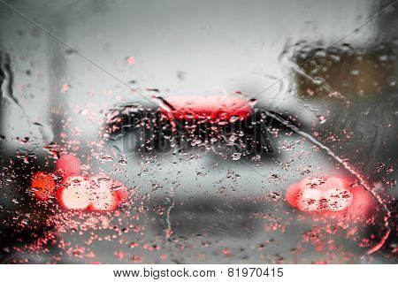 Car Lights Through The Wet Windshield