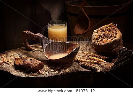 Kvass In A Wooden Ladle And In A Transparent Mug
