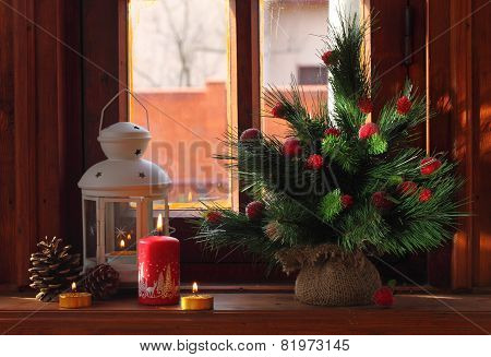 Small Lamp, Candles, Cones And A Decorative Fur-tree