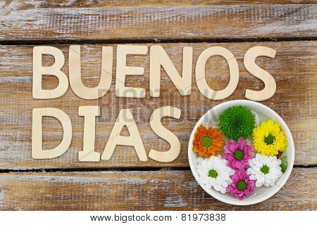 Buenos Dias (Good morning in Spanish) written with wooden letters, and santini flowers