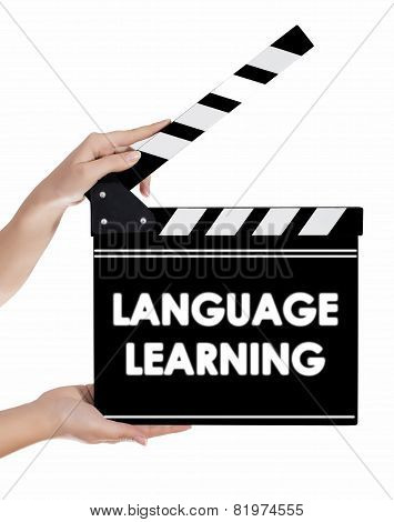 Hands Holding A Clapper Board With Language Learning Text