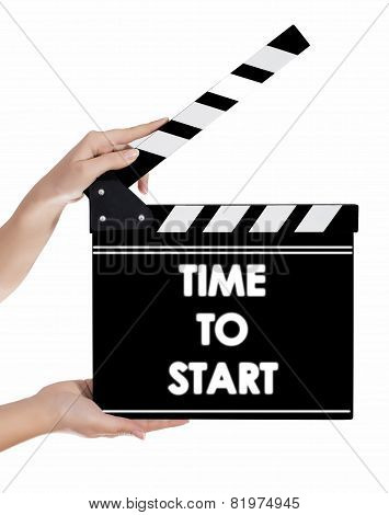 Hands Holding A Clapper Board With Time To Start Text