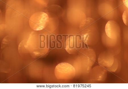 Festive gold background with bokeh effect