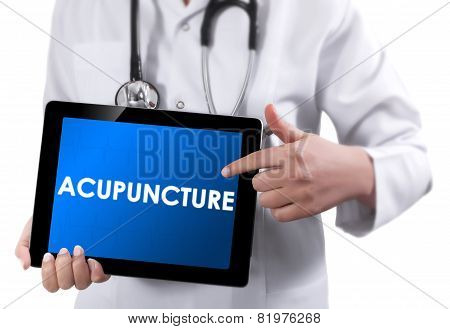 Doctor Showing Tablet With Acupuncture Text.