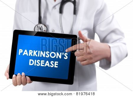 Doctor Showing Tablet With Parkinson's Disease Text.