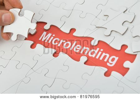 Microlending Text Under White Jig Saw Puzzle