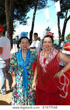 Spanish women in traditional dress.