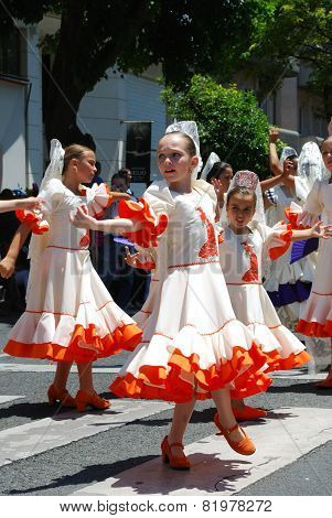 Young flamenco dancers in the street.